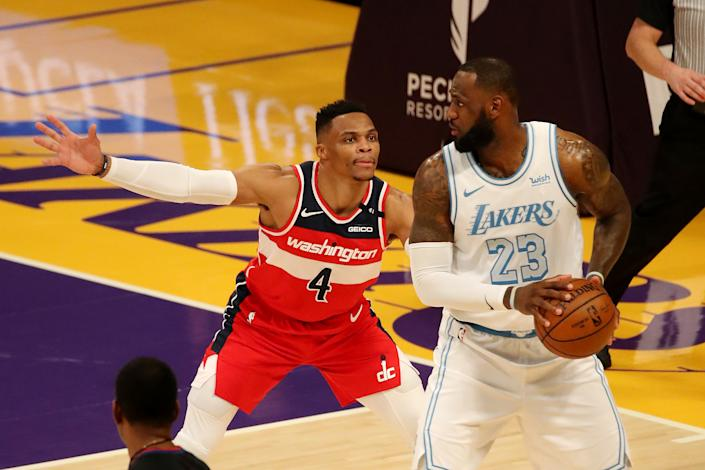 Russell Westbrook guards LeBron James.