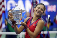 Emma Raducanu, of Britain, holds up the US Open championship trophy after defeating Leylah Fernandez, of Canada, during the women's singles final of the US Open tennis championships, Saturday, Sept. 11, 2021, in New York. (AP Photo/Seth Wenig)