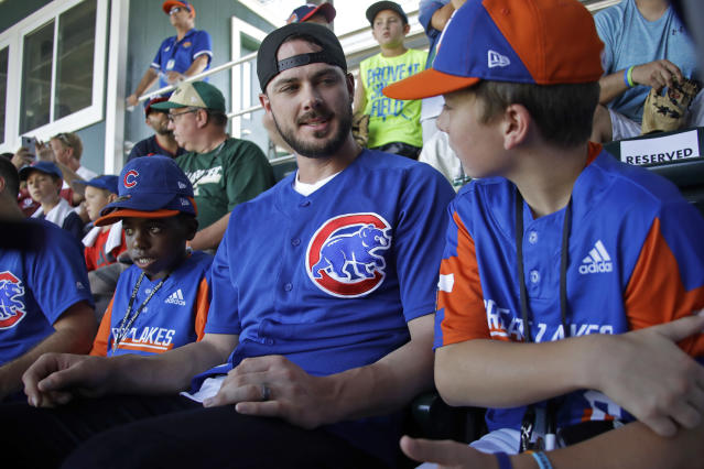 Chicago Cubs' Kris Bryant, center, talks with between Bowling Green, Kentucky's Grayson Newman, right, and Sol Guyer, left, in the stands at Volunteer Stadium during an International pool play baseball game at the Little League World Series tournament in South Williamsport, Pa., Sunday, Aug. 18, 2019. (AP Photo/Tom E. Puskar)