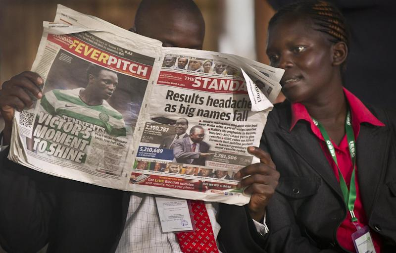 An election official reads a copy of The Standard newspaper while waiting for election results to be announced at the National Tallying Center, in Nairobi, Kenya Thursday, March 7, 2013. Kenyan media members told The Associated Press on Thursday that the Media Owners Association agreed not to sensationalize headlines or even put political press conferences live on the air, to avoid airing hate speech or political attacks that could incite violence, with the result of presidential elections to be announced later this week. (AP Photo/Ben Curtis)