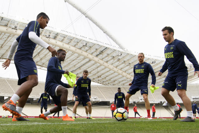 Swiss national team soccer players from left, Manuel Akanji, Jacques Francois Moubandje, Fabian Frei, Michael Lang and Mario Gavranovic play with a ball during a training session at the Olympic stadium, in Athens, Greece, Thursday, March 22, 2018. Switzerland will face Greece in Athens on March 23, 2018 for an International friendly soccer match. (Laurent Gillieron/Keystone via AP)