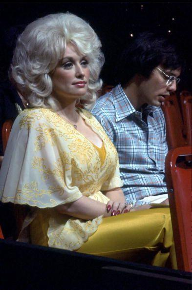 <p>While she may not be known as much for wearing yellow over white or pink, this has been a popular color choice for the singer over the years. It was during the '80s that Parton began to develop her vibrant, larger-than-life style that matched her lovable persona.</p>