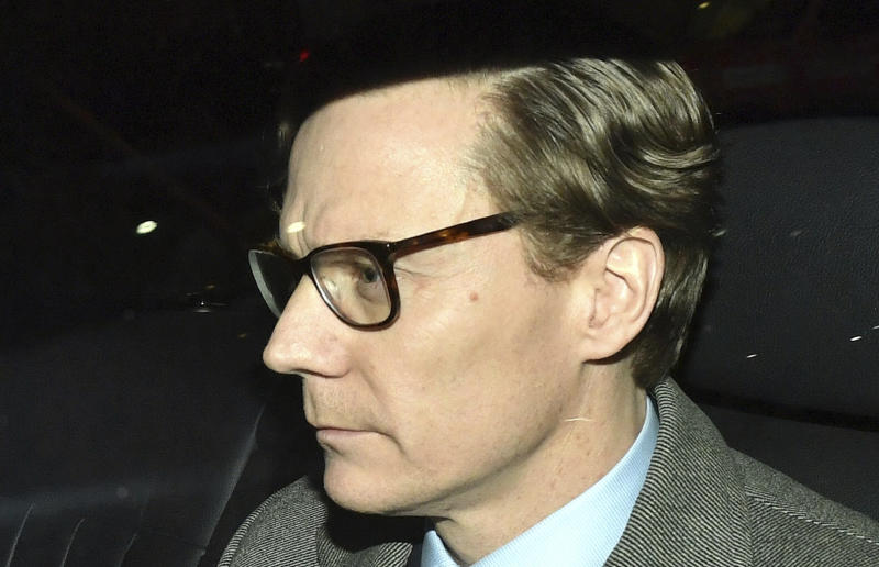 Chief Executive of Cambridge Analytica (CA) Alexander Nix, leaves the offices in central London (Dominic Lipinski/PA via AP)