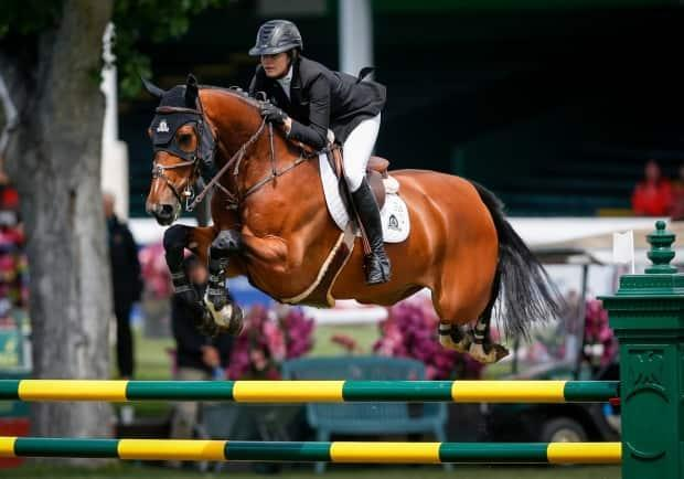 Canada's Tiffany Foster, seen in this file photo from 2019, won the 1.50-metre horse jumpingcompetition at the Spruce MeadowsATCO Classic Grand Prix on Sundayin southwest Calgary. (Jeff McIntosh/The Canadian Press  - image credit)