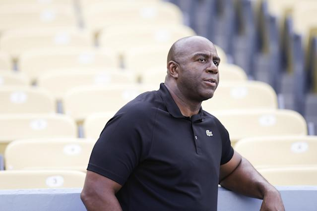 "Los Angeles Dodgerst owner Earvin ""Magic"" Johnson looks on before a baseball game between the Los Angeles Dodgers and the Arizona Diamondbacks on Tuesday, Sept. 10, 2013, in Los Angeles. (AP Photo/Jae C. Hong)"