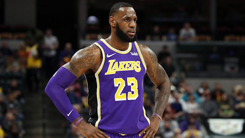 hot sale online 297b4 d6297 LeBron James sits by himself in Lakers' loss as NBA trade ...