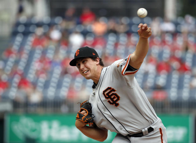 San Francisco Giants starting pitcher Derek Holland throws during the first inning of a baseball game against the Washington Nationals at Nationals Park, Sunday, June 10, 2018, in Washington. (AP Photo/Alex Brandon)