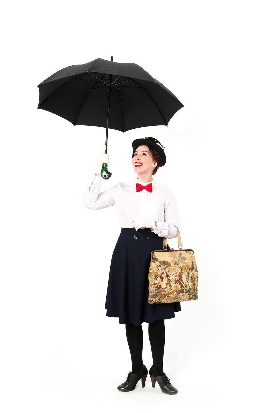 """<p>Not only is our favorite magical nanny a brunette, her timeless look is also incredibly easy to emulate with just an umbrella, bowler hat and a pinned red bow on your white ruffled blouse. </p><p><a href=""""https://keikolynn.com/2016/10/mary-poppins-and-bert-couples-costume/"""" rel=""""nofollow noopener"""" target=""""_blank"""" data-ylk=""""slk:Get the tutorial at Keiko Lynn »"""" class=""""link rapid-noclick-resp""""><em>Get the tutorial at Keiko Lynn » </em></a> </p>"""