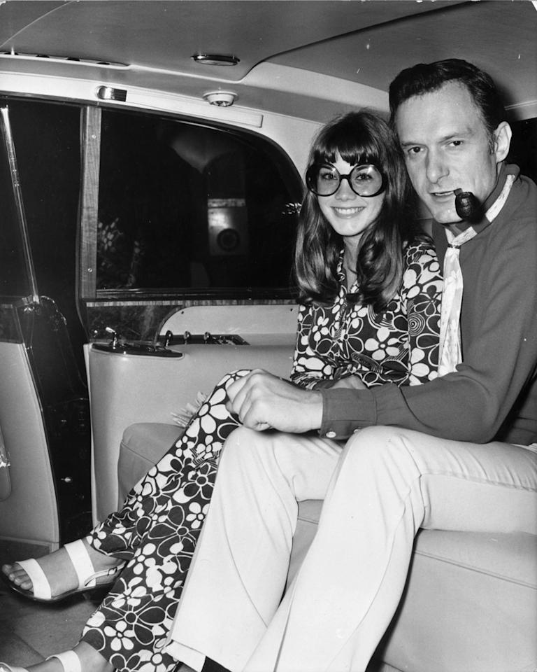 6th September 1969:  American pornograpic magazine publisher and club owner Hugh Hefner with American actress Barbara Benton in a car, leaving London's Hilton Hotel for London airport.  (Photo by Keystone/Getty Images)