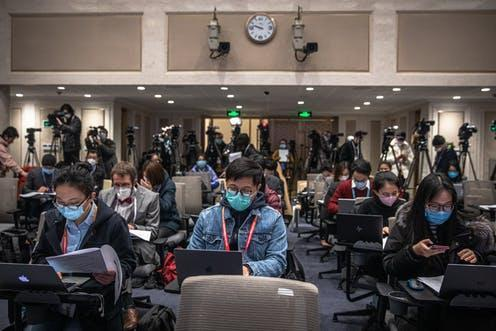 """<span class=""""caption"""">Journalists wait for a briefing at China's National Bureau of Statistics.</span> <span class=""""attribution""""><span class=""""source"""">Roman Pilipey/EPA</span></span>"""