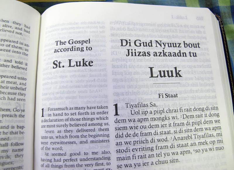 """In this Dec. 3, 2012 photo, the first page of the Gospel according to St. Luke, or the """"Di Gud Nyuuz bout Jiizas azkaadn tu Luuk,"""" is shown at the office of the Bible Society of the West Indies in Kingston, Jamaica. After years of translation from the original Greek, the Bible Society is releasing in Jamaica print and audio CD versions of the first patois translation of the New Testament, or """"Di Jamiekan Nyuu Testiment."""" For patois expert Hubert Devonish, a linguist who is coordinator of the Jamaican Language Unit at the University of the West Indies, the Bible translation is a big step toward getting the state to eventually embrace the creole language created by slaves. (AP Photo/David McFadden)"""
