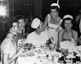 <p>Five Kennedy women—Jackie, Patricia Lawford, Ethel Kennedy, Eunice Shriver, and Jean Kennedy—attend a party. </p>