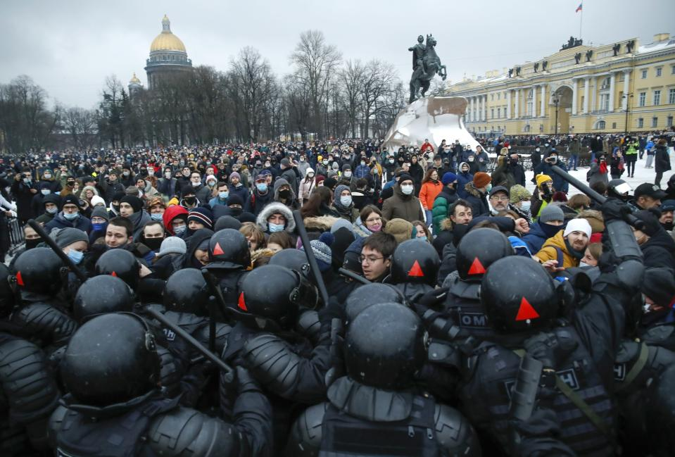 People clash with police during a protest against the jailing of opposition leader Alexei Navalny in St. Petersburg, Russia, Saturday, Jan. 23, 2021. Police on Saturday arrested hundreds of protesters who took to the streets in temperatures as low as -50 degrees Celcius (-58 degrees Fahrenheit) to demand the release of Alexei Navalny, the country's top opposition figure. Navalny, President Vladimir Putin's most prominent foe, was arrested on Jan. 17 when he returned to Moscow from Germany, where he had spent five months recovering from a severe nerve-agent poisoning that he blames on the Kremlin. (AP Photo/Dmitri Lovetsky)