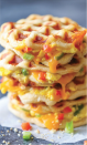 """<p>Loaded with peppers, eggs, and cheddar cheese, these savory waffles will be one of the tastiest—and easiest—breakfasts you've ever made.</p><p><strong>Get the recipe at <a href=""""https://damndelicious.net/2016/08/30/breakfast-stuffed-waffles/"""" rel=""""nofollow noopener"""" target=""""_blank"""" data-ylk=""""slk:Damn Delicious"""" class=""""link rapid-noclick-resp"""">Damn Delicious</a>.</strong></p>"""