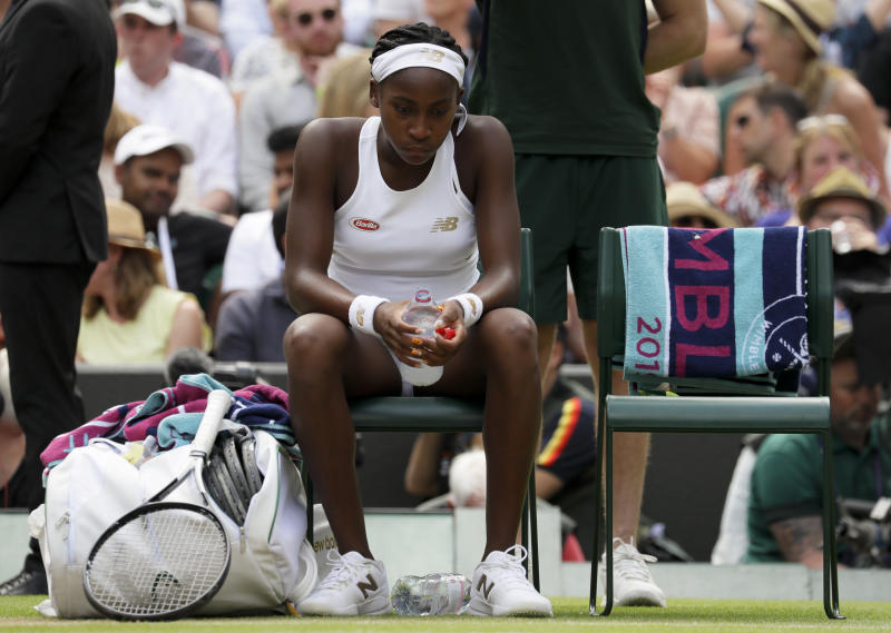 """United States' Cori """"Coco"""" Gauff is dejected after losing to Romania's Simona Halep in a women's singles match against on day seven of the Wimbledon Tennis Championships in London, Monday, July 8, 2019. (AP Photo/Kirsty Wigglesworth)"""