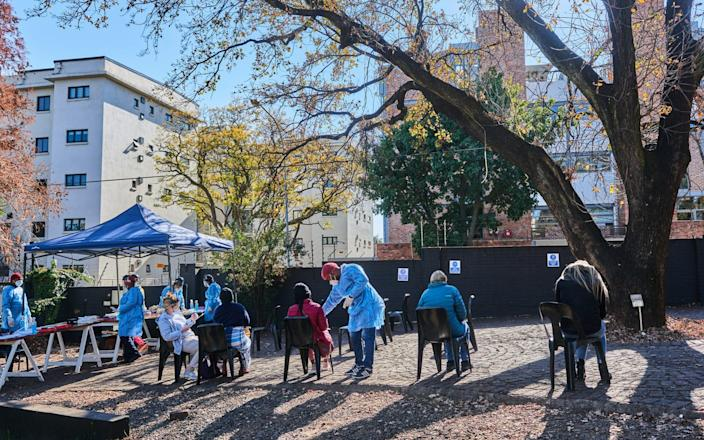 People wait to be swab tested at a Testaro Covid-19 testing site/laboratory in the Dunkeld suburb of Johannesburg, South Africa, on Thursday, July 1, 2021. - Bloomberg