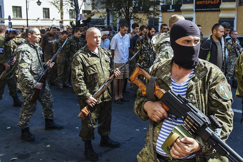 Pro-Russian gunmen guard parade dozens of captured Ukrainian soldiers during a march in mockery of the country's Independence Day celebrations in the main separatist stronghold Donetsk on August 24, 2014