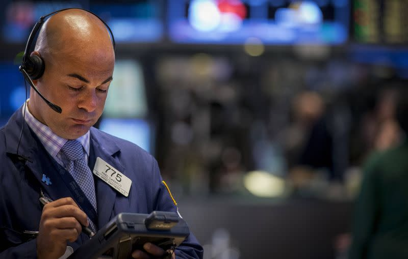 Trader Fred DeMarco works on the floor of the New York Stock Exchange