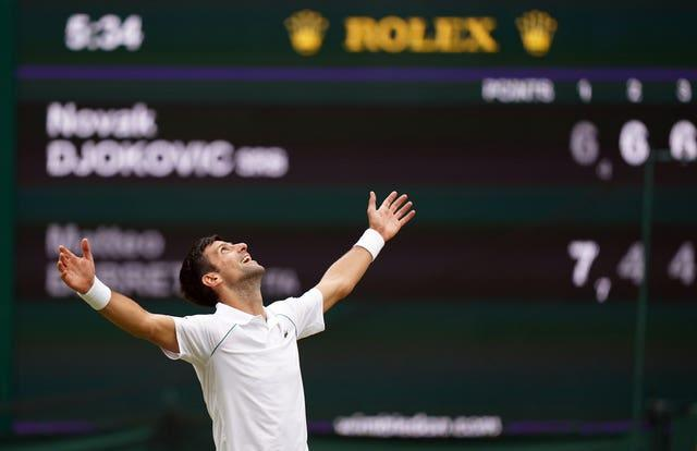 Novak Djokovic raises his arms and looks to the skies after winning another Wimbledon title