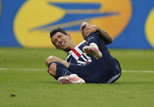 PSG's Angel Di Maria, reacts after Lyon's Rafael, stopped with a foul during the French League Cup soccer final match between Paris Saint Germain and Lyon at Stade de France stadium, in Saint Denis, north of Paris, Friday, July 31, 2020. Rafael received the red card. (AP Photo/Francois Mori)