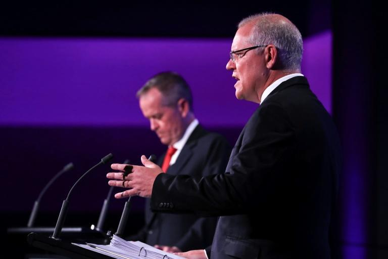 Australian Prime Minister Scott Morrison (R) pulled off what he declared a 'miracle' win in last year's vote