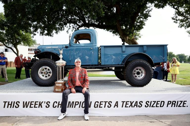"""""""I'm a big guy with a big truck with a big jacket and a big paycheck"""" -- Jason Kokrak celebrates with a clasic truck given to him after winning the 2021 Charles Schwab Challenge at Colonial Country Club in Fort Worth, Texas"""