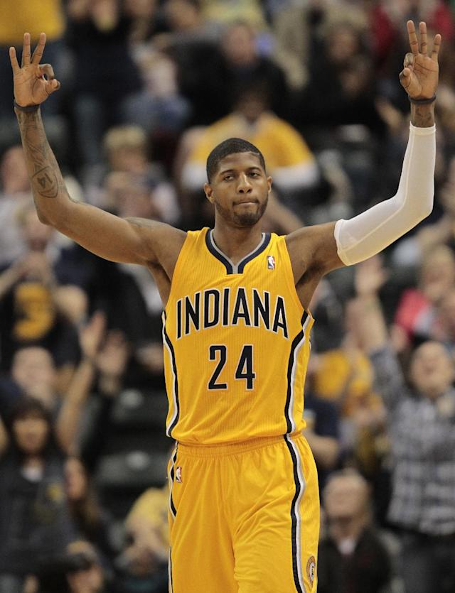 Indiana Pacers forward Paul George reacts to hitting a 3-point shot against the Detroit Pistons during the first half of an NBA basketball game in Indianapolis, Wednesday, April 2, 2014. (AP Photo/AJ Mast)
