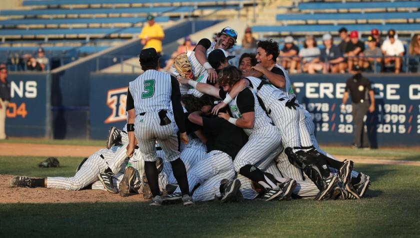 FULLERTON, CA - JUNE 19, 2021: Thousand Oaks celebrates their 3-2 win over Trabuco Hills in the CIF Southern Section Division 2 Championship at Cal State Fullerton on June 19, 2021 in Fullerton, California.(Gina Ferazzi / Los Angeles Times)