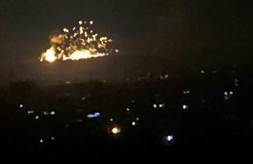 An image grab shows smoke and fire billowing during an Israeli air strike on the outskirts of Damascus