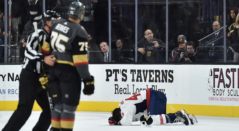5e9436d1 Tom Wilson lays on the ices after a hit by Ryan Reaves of the Vegas Golden  Knights. (Photo by David Becker/NHLI via Getty Images)