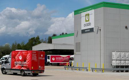 FILE PHOTO: A delivery van leaves the dispatch area of the Ocado CFC (Customer Fulfilment Centre) in Andover