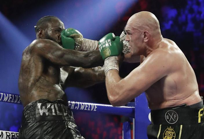 Tyson Fury punches Deontay Wilder.