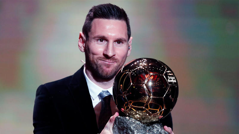 Lionel Messi smiling after winning a record sixth Ballon D'or award.