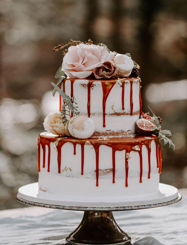 """<p>A semi-naked drip cake crafted by <a href=""""http://www.amyssweetbakeshop.org/"""" target=""""_blank"""">Amy's Sweet Bake Shop</a> is classically autumnal, topped with seasonal roses and greenery. </p><p><em>Via <a href=""""https://greenweddingshoes.com/youve-got-to-see-the-bridesmaids-in-jewel-tones-floral-hoops-in-this-luxe-autumn-wedding-inspiration/"""" target=""""_blank"""">Green Wedding Shoes</a></em></p>"""