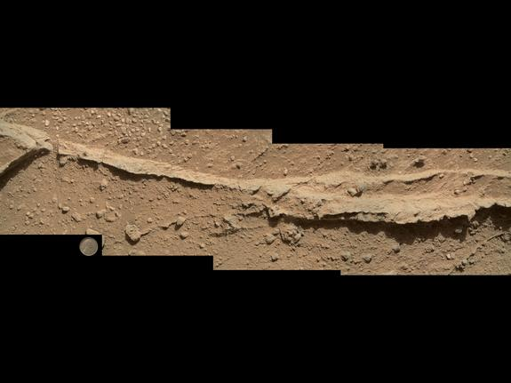 """This mosaic of four images taken by the Curiosity rover's Mars Hand Lens Imager camera on Sept. 21, 2013 shows detailed texture in a ridge of rock at a location called """"Darwin"""" inside Gale Crater."""