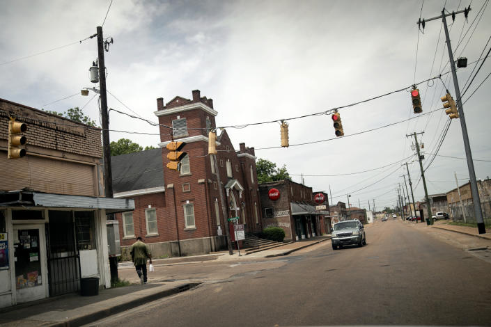 A man walks down a quiet street in downtown Greenwood, Miss., Tuesday, June 11, 2019. The city was a flashpoint for voter registration drives in the 1960s. (AP Photo/Wong Maye-E)