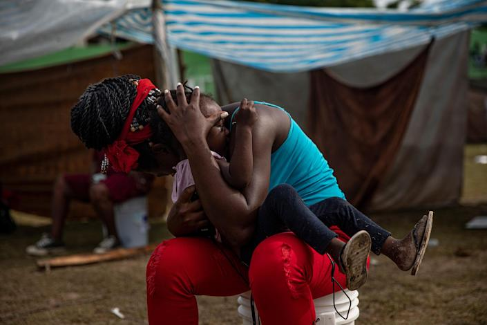 """People displaced by the earthquake at a makeshift tent camp in Les Cayes on Aug. 19.<span class=""""copyright"""">Adriana Zehbrauskas—The New York Times/Redux</span>"""