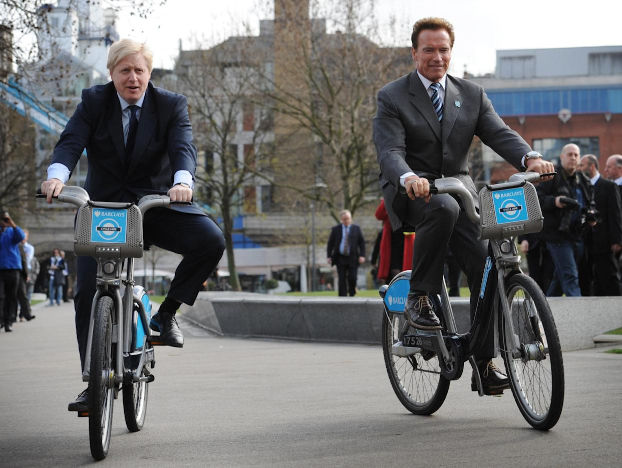 London Mayor Boris Johnson takes former Governor of California Arnold Schwarzenegger (right) for a ride on one of his 'Boris bikes' during his visit to City Hall in London.