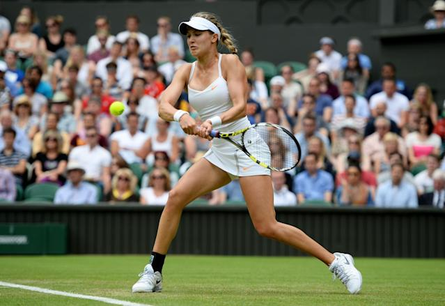 LONDON, ENGLAND - JUNE 26: Eugenie Bouchard of Canada plays a backhand during her Ladies' Singles second round match against Ana Ivanovic of Serbia on day three of the Wimbledon Lawn Tennis Championships at the All England Lawn Tennis and Croquet Club on June 26, 2013 in London, England. (Photo by Mike Hewitt/Getty Images)