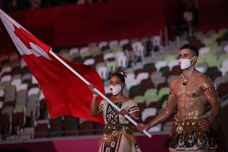 Pita Taufatofua  could be seen topless while waving his country's flag (AFP via Getty Images)