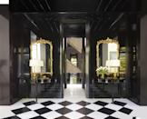 """<p>For the entry hall of a Toronto home, Dallas-based designer <a href=""""https://janshowers.com/"""" rel=""""nofollow noopener"""" target=""""_blank"""" data-ylk=""""slk:Jan Showers"""" class=""""link rapid-noclick-resp"""">Jan Showers</a> painted both the walls and ceilings a dramatic high-gloss black, creating a striking contrast to the white rooms beyond. The demilune console tables are from the designer's own <a href=""""https://janshowers.myshopify.com/collections/the-collection"""" rel=""""nofollow noopener"""" target=""""_blank"""" data-ylk=""""slk:collection"""" class=""""link rapid-noclick-resp"""">collection</a>. </p>"""