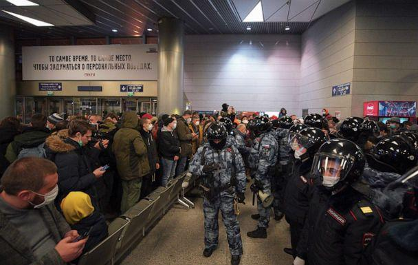 PHOTO: In this handout photo, law enforcement officers stand guard before the expected arrival of Russian opposition leader Alexei Navalny on a flight from the German capital Berlin at Vnukovo International Airport in Moscow, Jan. 17, 2021. (Handout via Reuters)