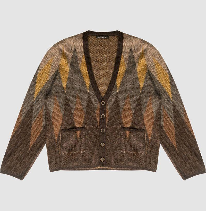 """<p>brwnstne.co</p><p><strong>$490.00</strong></p><p><a href=""""https://brwnstne.co/collections/release-007-outerwear/products/argyle-knitted-mohair-cardigan"""" rel=""""nofollow noopener"""" target=""""_blank"""" data-ylk=""""slk:Shop Now"""" class=""""link rapid-noclick-resp"""">Shop Now</a></p>"""