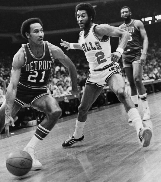 FILE - In this April 5, 1974 file photo, Detroit Pistons' Dave Bing (21) drives past Chicago Bulls' Norm Van Lier (2) during an NBA basketball game in Chicago. The former NBA great, who transitioned smoothly to owner and founder of a steel supply company, became Mayor of Detroit in 2009. In basketball and business, he never side-stepped a challenge, but the overwhelming weight of Detroit's financial problems and other troubles have convinced Bing to pass control of the city over to the state. (AP Photo/Fred H. Jewel, File)