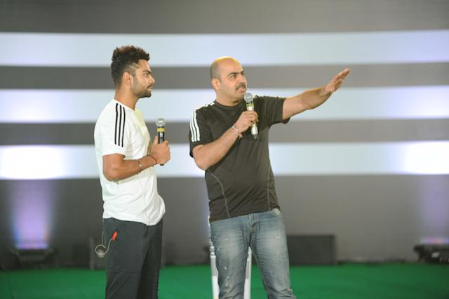 Virat Kohli and Tushar Goculdas, Brand Director, Adidas India