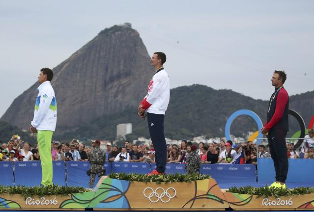 2016 Rio Olympics - Sailing - Victory Ceremony - Men's One Person Dinghy (Heavyweight) - Finn - Marina de Gloria - Rio de Janeiro, Brazil - 16/08/2016. Vasilij Zbogar (SLO) of Slovenia, Giles Scott (GBR) of Britain and Caleb Paine (USA) of USA are pictured on podium. REUTERS/Benoit Tessier FOR EDITORIAL USE ONLY. NOT FOR SALE FOR MARKETING OR ADVERTISING CAMPAIGNS.
