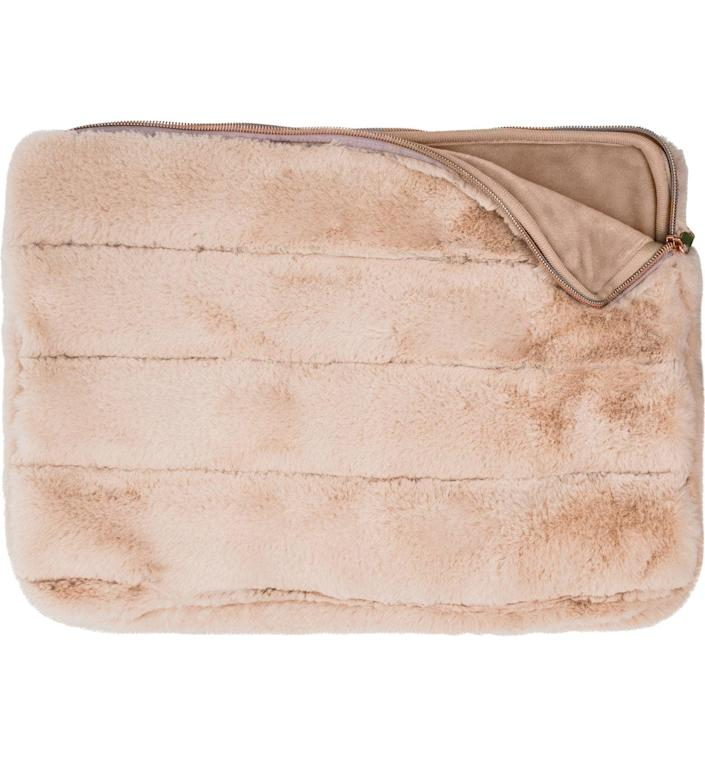 <p>Keep their laptop safe in this soft <span>Mytagalongs Faux Fur 15-Inch Laptop Sleeve</span> ($40).</p>