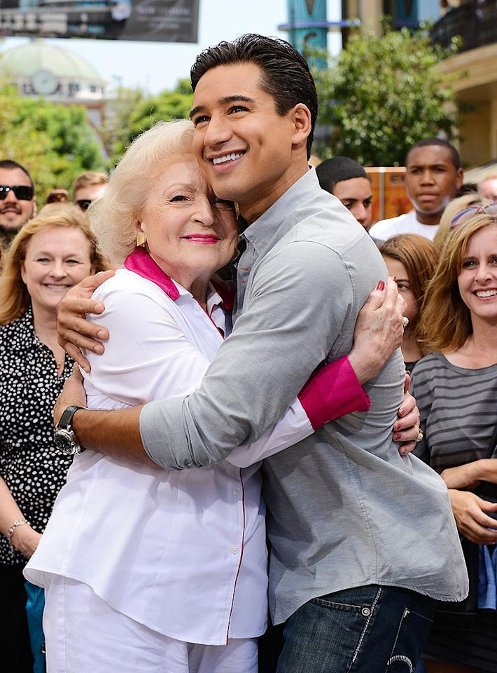 "<p class=""MsoNormal"">  </p><p class=""MsoNormal""><span>They may be nearly 50 years apart in age, but legendary actress Betty White and ""Extra"" host Mario Lopez seemed to get along swimmingly when she stopped by the show in L.A. on Wednesday. When asked about her sitcom ""Hot in Cleveland,"" Betty explained she couldn't believe she was on yet another successful TV show with another great group of women. (The first one, of course, was ""Golden Girls."") ""I'm the luckiest old broad on two feet!"" she admitted. (8/22/2012) </span></p>"