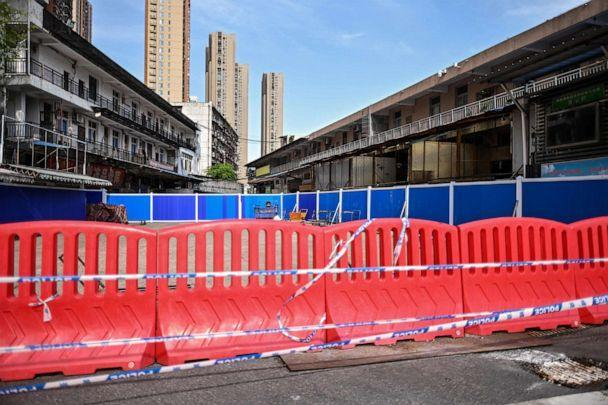 PHOTO: Barriers are setup at the closed Huanan Seafood Market where the COVID-19 coronavirus is believed to have emerged in Wuhan, China, April 15, 2020. (Hector Retamal/AFP via Getty Images, FILE)