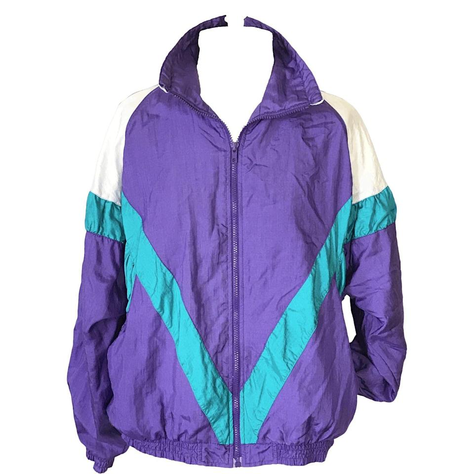 """<p><strong>Pro Spirit</strong></p><p>shopthrilling.com</p><p><strong>$25.00</strong></p><p><a href=""""https://shopthrilling.com/collections/all/products/90s-windbreaker-by-pro-spirit"""" rel=""""nofollow noopener"""" target=""""_blank"""" data-ylk=""""slk:Shop Now"""" class=""""link rapid-noclick-resp"""">Shop Now</a></p><p>This color-blocked windbreaker is the perfect layering piece. Pair with jeans or leggings for a casual weekend look.</p>"""